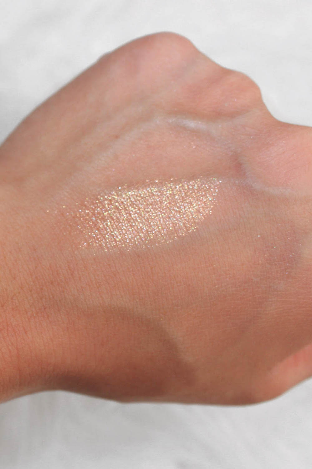 Artist Couture DIAMOND GLOW POWDER Conceited | 5 holiday party glitter makeup products | The Beauty List | The Beauty Vanity
